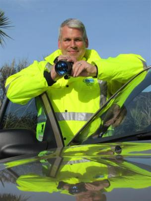 Wanaka Community Patrol chairman Steve Worley, with his night-vision device, preparing for his...