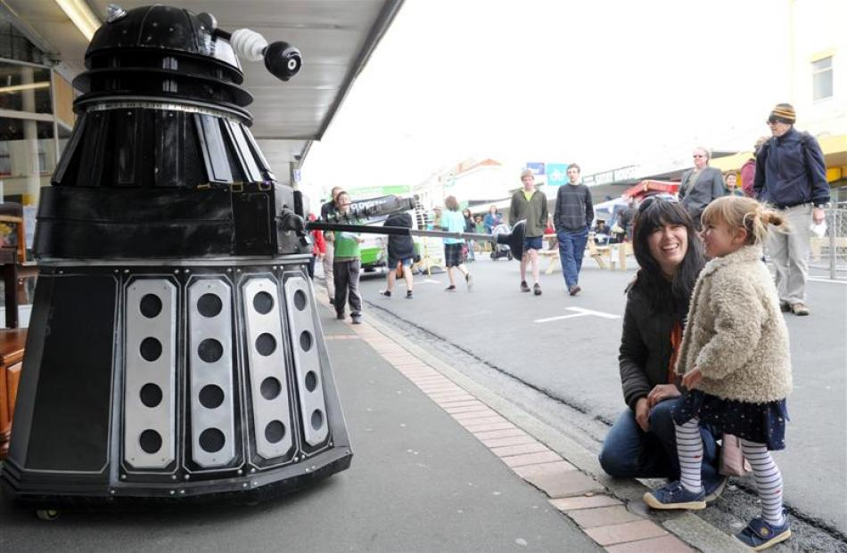 Warren Goodwin, as a Dalek, performs for Kotomiyo (3) and her mother Yoshiko Cowell, of Dunedin,...