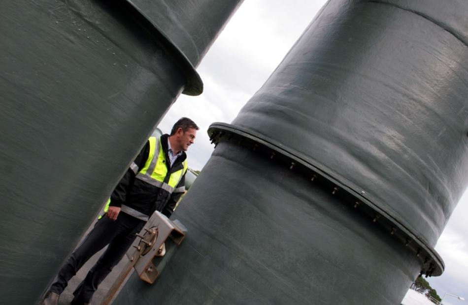 Wastewater treatment manager Chris Henderson takes a stroll through the recently completed water...