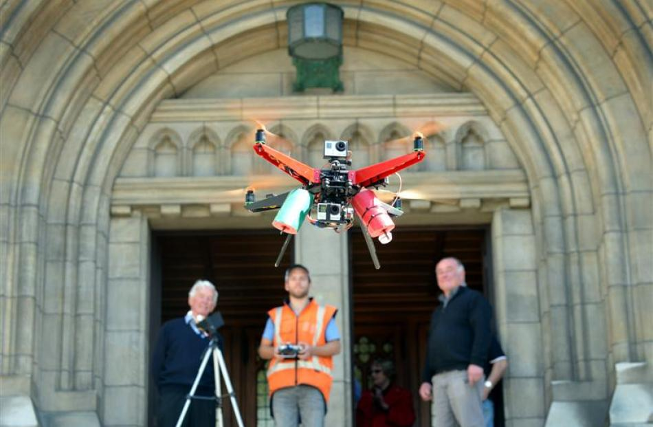 Watching the XP2 Monster Quadcopter  at St Paul's Cathedral yesterday are (from left) cathedral...