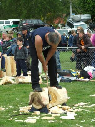 Wayne Corbin, of Riverton, competes in the woodchopping section.