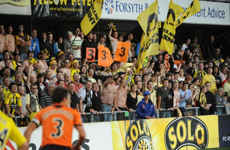 Wellington Phoenix fans cheer their team as it plays the Brisbane Roar at Forsyth Barr Stadium in...