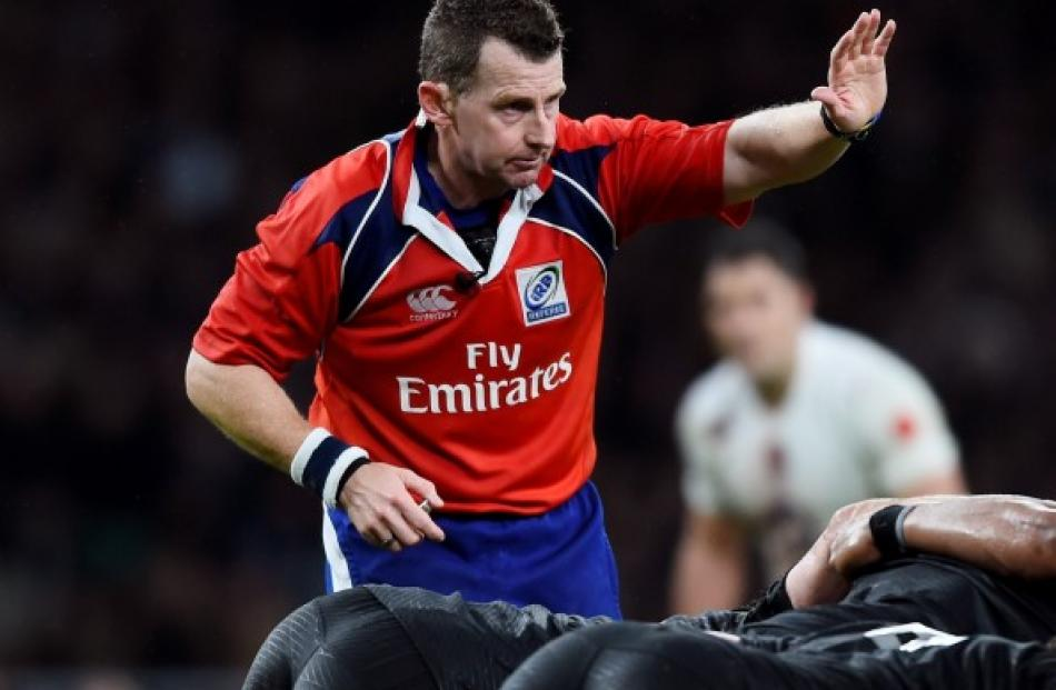 Welsh referee Nigel Owens in action during the test between England and the All Blacks at...