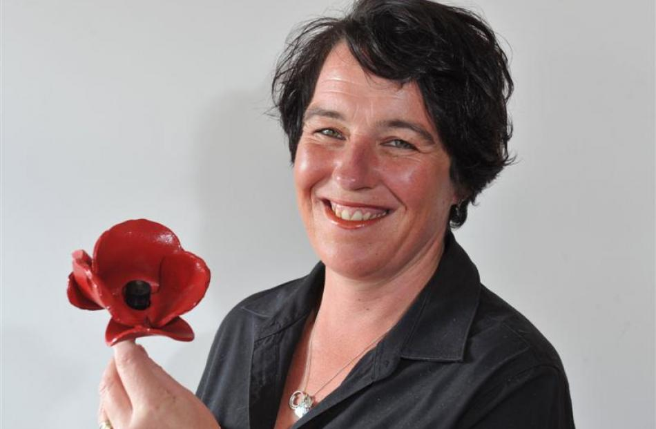 Wendy Boyne, of the Mosgiel RSA, holds the Tower of London Ceramic Poppy  given  to the Mosgiel...