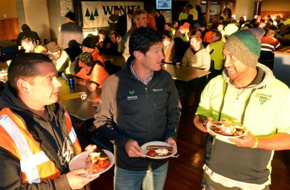 Wenita Forest Products chief executive David Cormack (centre) shares breakfast and a joke with...