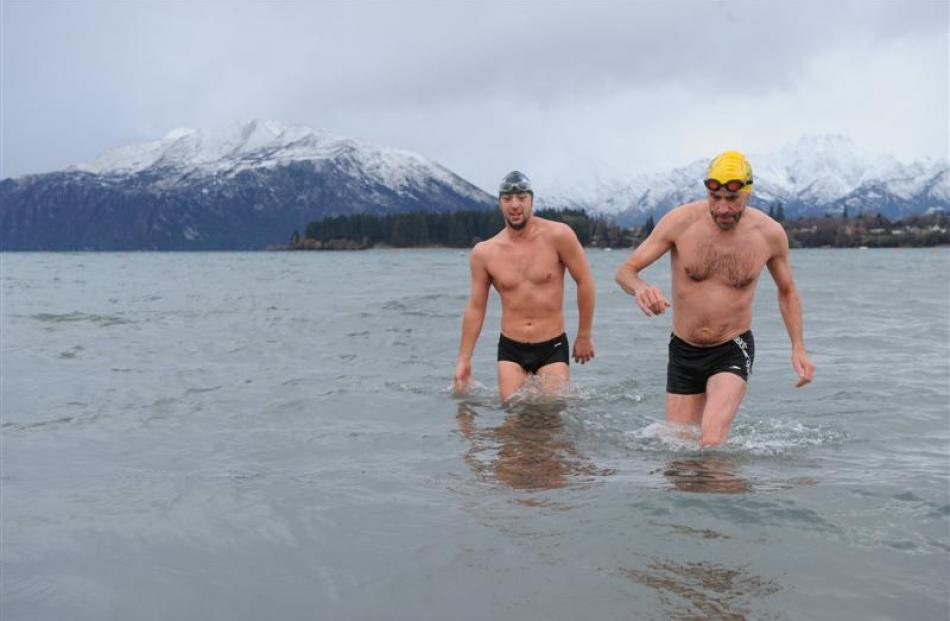 Sylvain Estadieu (left) and the late Pariac  Casey emerge from a chilly Lake Wanaka in July 2011...