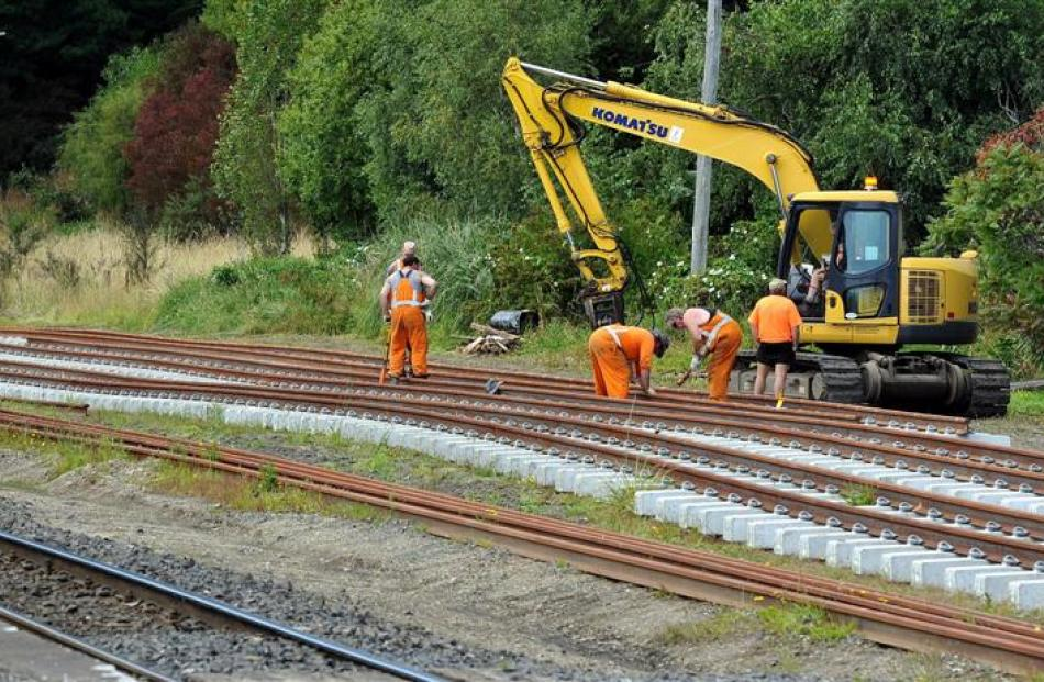 Workers assemble railway tracks at the old Wingatui rail-yard to test the safest way to replace...