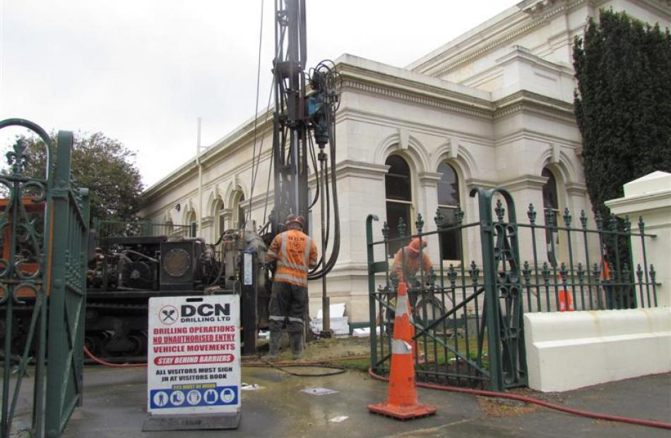 Workmen begin drilling boreholes at the Oamaru Courthouse as part of work to establish the cost...