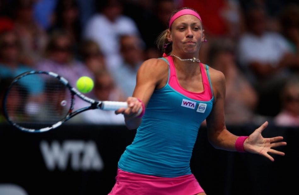 Yanina Wickmayer of Belguim plays a forehand in her semifinal match against Mona Barthel of...