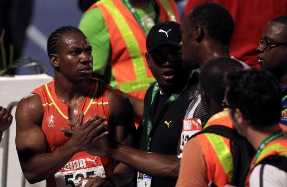 Yohan Blake (L) shakes hands with Usain Bolt after the men's 200m final at the Jamaican Olympic...