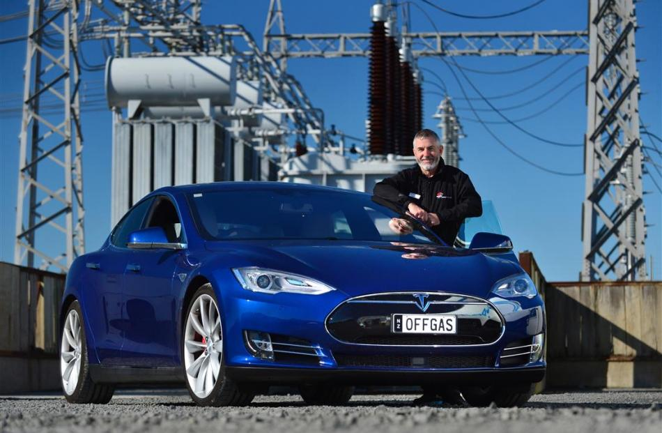 Better New Zealand trustee Sean Dick with his $220,000 Tesla S P90D electric supercar in Dunedin...