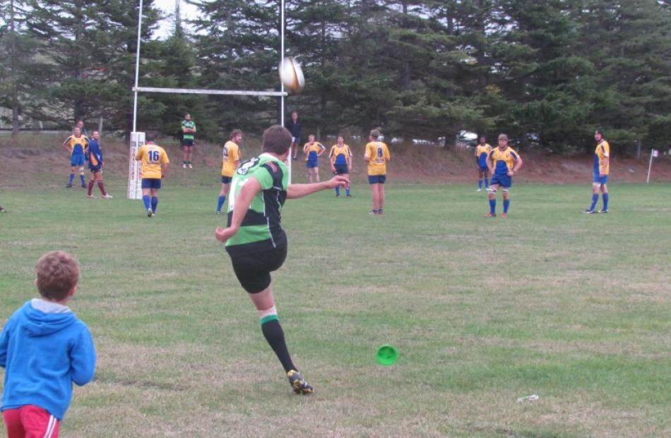 Craig Smith, who was playing cricket for Otago just a few weeks ago, kicks a goal for Maheno in...