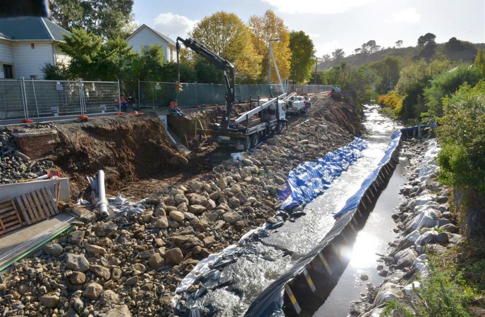 Flood protection work continues in and near the Water of Leith, beside Montgomery Ave, in Dunedin...