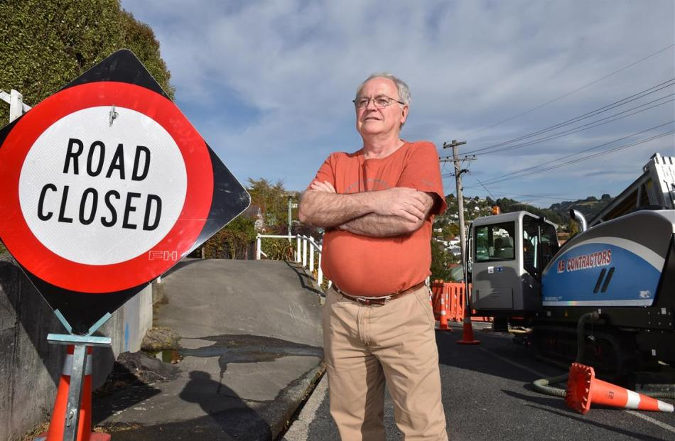 Kaikorai resident Peter Waterman is upset at the state of the roading in his suburb as extensive...