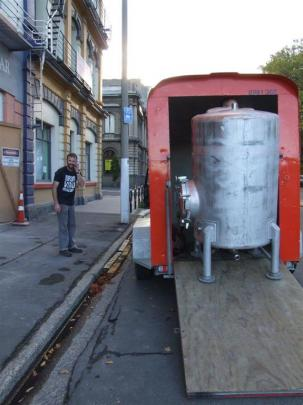 Winemaker Brendan Seal moves winemaking equipment into the former Gresham Hotel. Photos supplied.