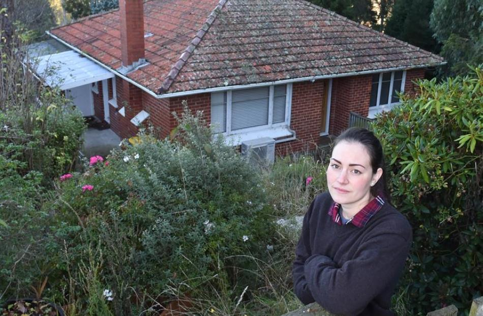 Amanda Bradley outside her house at 36 Torquay St Abbotsford, which is uninhabitable due to land...