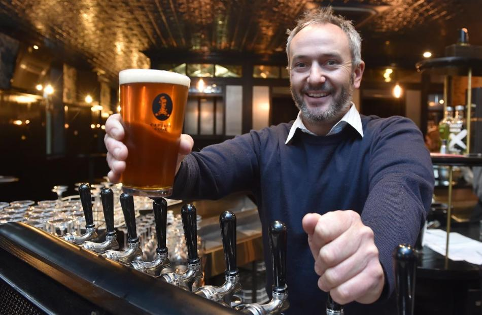 Operations manager Sheldon Lye, with a freshly poured beer at Dunedin's Captain Cook Hotel....