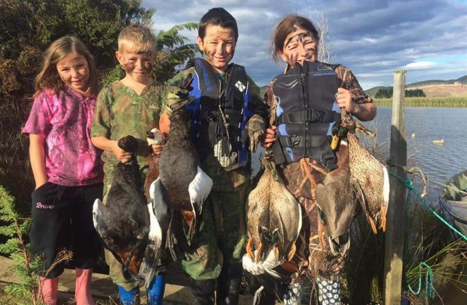 Duck shooting was a family affair at Lake Waipori on the opening day of the season. Showing off...