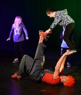 Sophie Horton (8, left), of Lee Stream, watches as Shannon McGurgan (Mac the clown) lifts Phoenix...