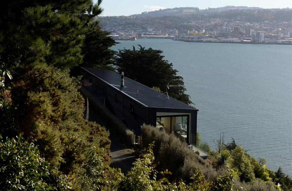 The long narrow shape of this house was dictated by the steep Otago Peninsula site, which drops...