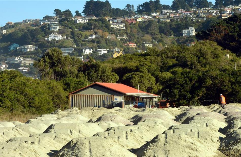 Truckloads of sand are stockpiled at Kettle Park for Ocean Beach dune repairs. Photo by Stephen...