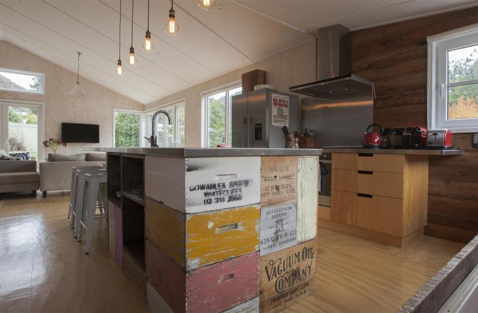 Bee boxes and whisky cases are built into the kitchen bench in this Arrowtown holiday home....