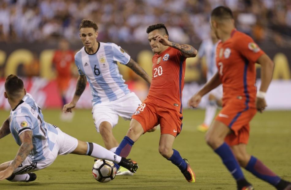 Chile Midfielder Charles Aranguiz 20 Losing Ball To Argentina Defender Nicolas Otamendi 17