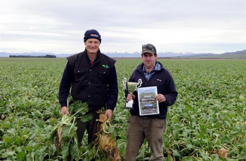 Johnny Duncan (left) and Shane Lyon stand in the overall prize-winning crop in the Maniototo...