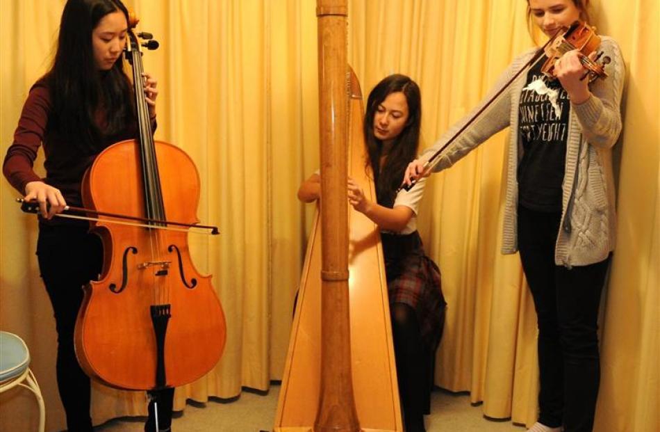 Logan Park High School trio Ball of Confusion, (from left) Pun Leelaket (cello), Rikke Kikkawa...