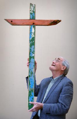Mornington Methodist Church organist and choir master Emeritus Prof Colin Gibson holds the...