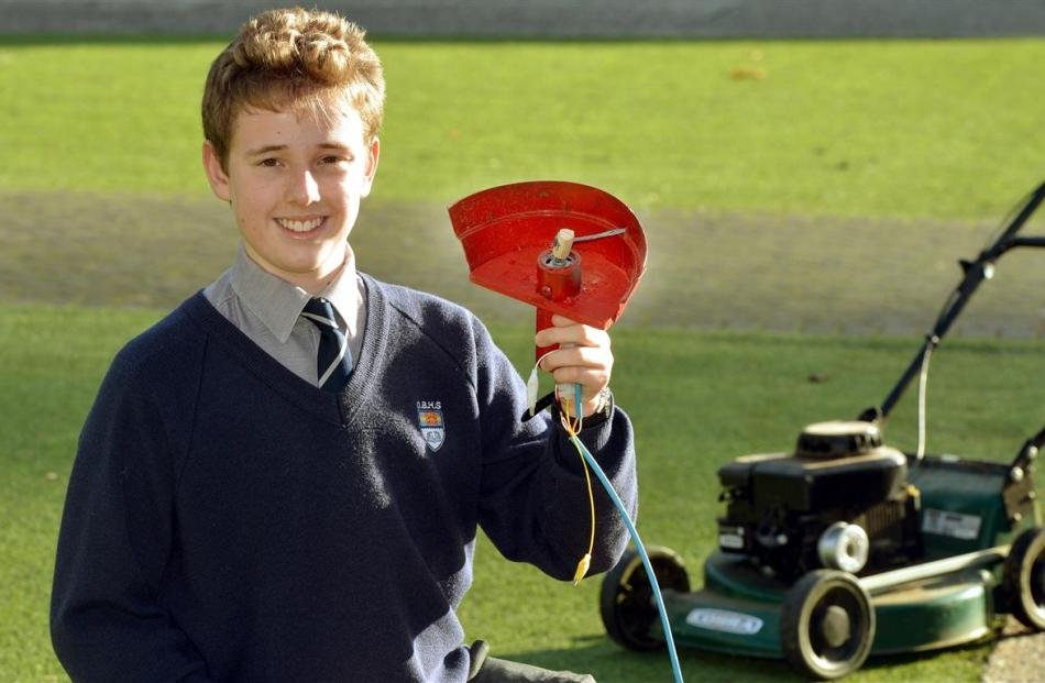 Sam Hewson with his clip-on lawn edger for lawnmowers. Photo by Stephen Jaquiery.