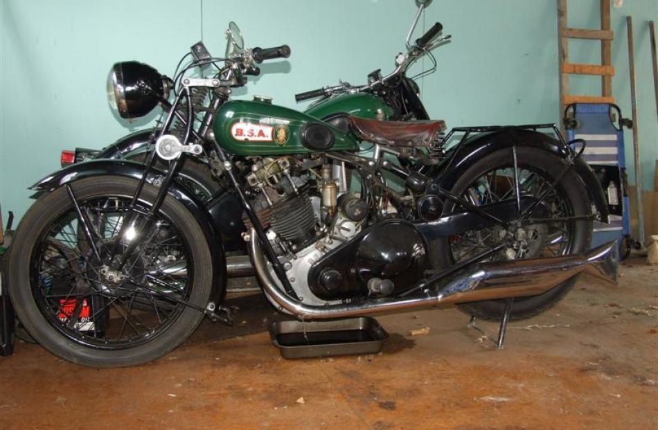 A 1930 500cc BSA sloper motorbike and a 1951 350cc BSA (obscured).