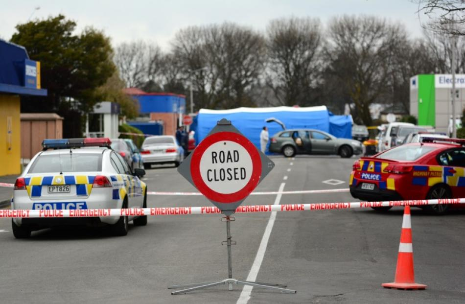 A crime scene is set up at Ashburton Work and Income Centre after two people were shot dead and a...