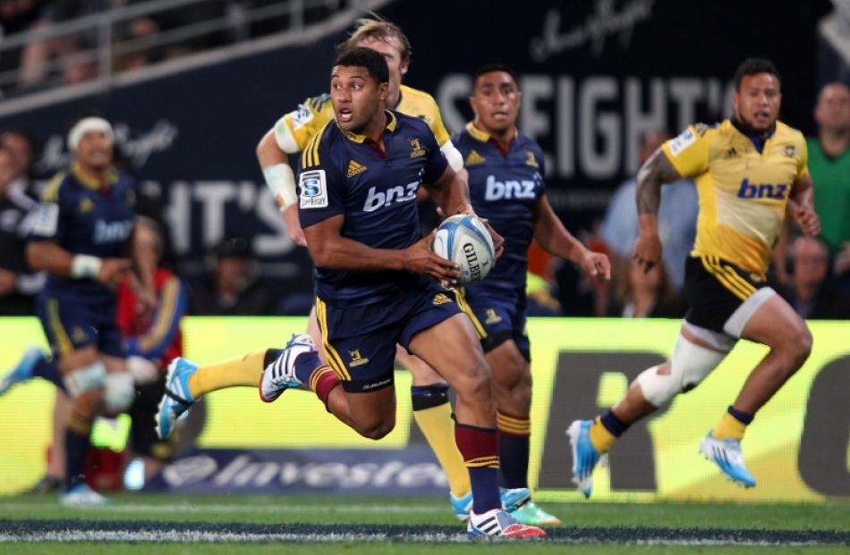 Lima Sopoaga of the Highlanders on the attack during the Super Rugby match between the...