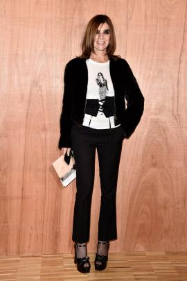 Carine Roitfeld wears a wait-corset over a tshirt at Givenchy