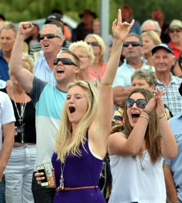 Celebrating their win during the Omakau Races yesterday are (from left) Quinton Wicks (27), of...