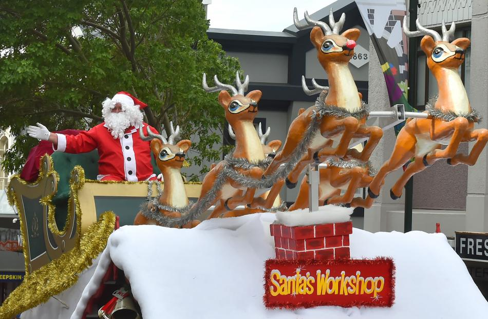 Santa and his reindeer make a triumphant appearance at the end of the Dunedin Christmas parade....