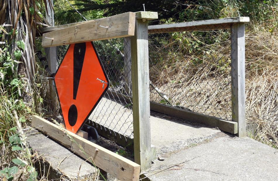 Unknown persons removed wooden boards and a sign blocking access.