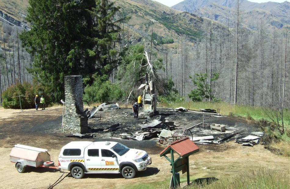 All that remains of the historic Mount Aurum Homestead are two chimneys and charred roofing iron.