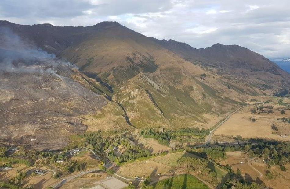 An aerial photo of the smoke rising from the Mt Roy fire in Wanaka this morning. Photo: Fire and Emergency New Zealand