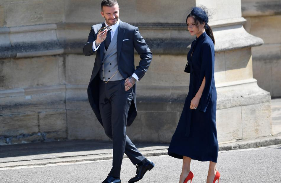 David and Victoria Beckham arrive to the wedding of Britain's Prince Harry to Meghan Markle in...