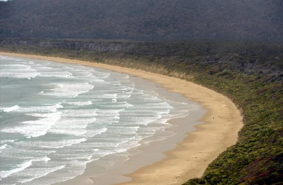 A person has the beach to themself at Tautuku Bay (below) on the Southern Scenic Route.