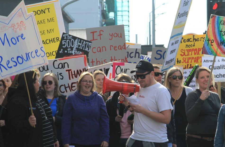 A crowd of about 200, including 133 teachers from 16 North Otago schools, march through Oamaru for smaller class sizes and a pay hike to address a teacher shortage. Photo: Hamish MacLean