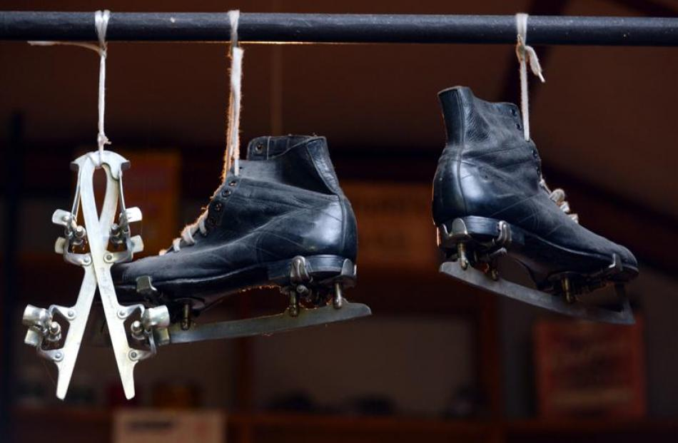 Ice skates hang from the ceiling.