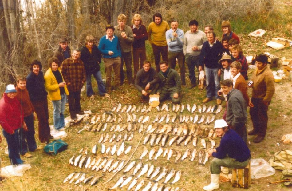 Fishermen pictured at the Red Bridge show off many of the 136 fish caught during the 1976...