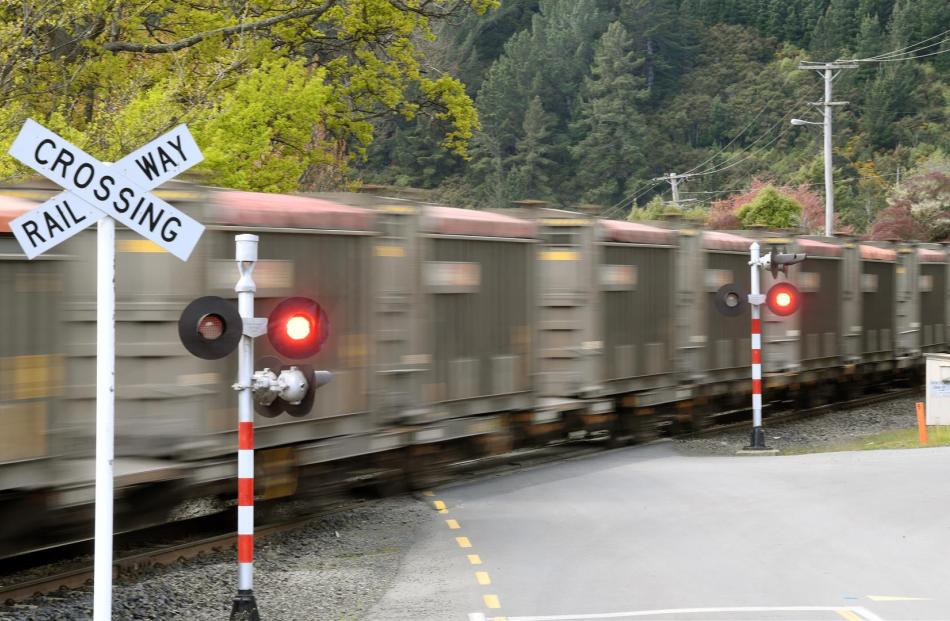 A Dunedin photographer, Jordy Cleaver, captures images of pedestrians walking in front of approaching trains, prompting a warning from KiwiRail for people to be alert to the dangers. PHOTOS: STEPHEN JAQUIERY AND JORDAN CLEAVER