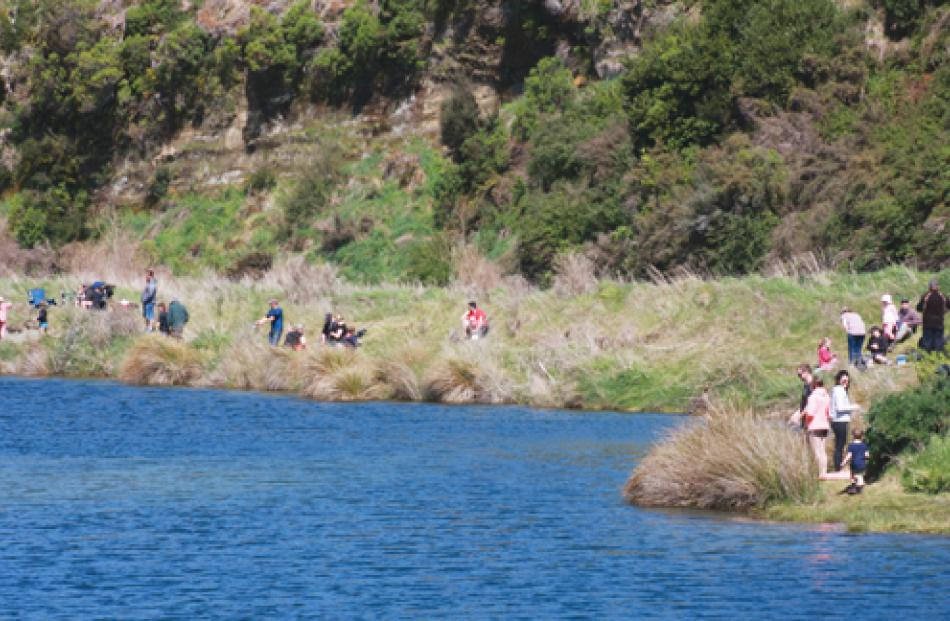 Take A Kid Fishing experience with young fisherfolk trying to catch the big one on the banks of...