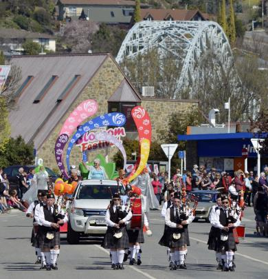 Pipers lead the  Senior Queens float along Tarbert St during the Grand Parade on Saturday.