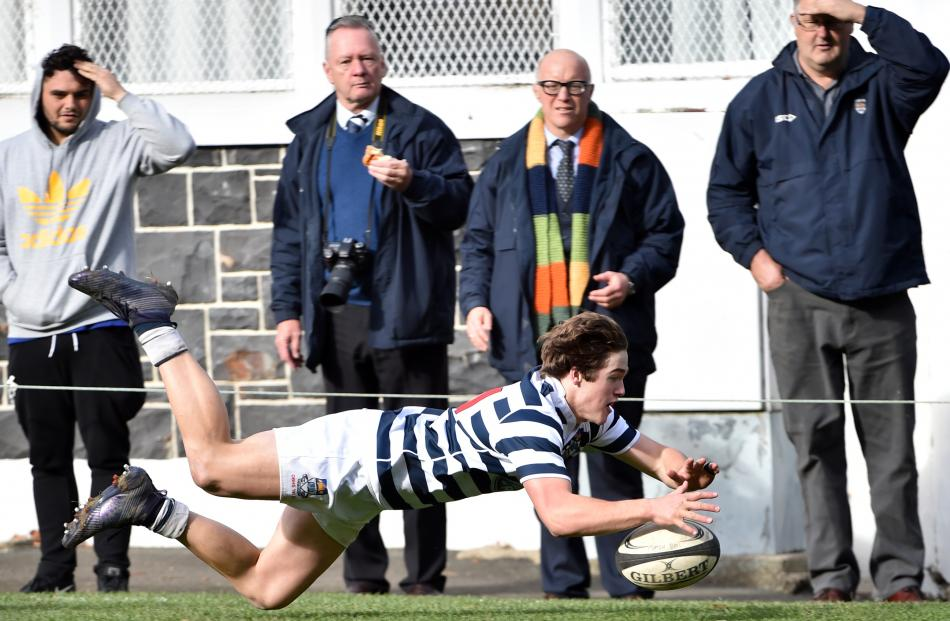 Otago Boys' High School First XV winger Michael Manson scores after chasing a kick at...