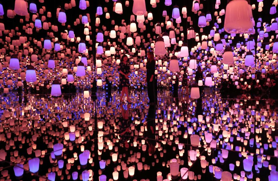 U.S. first lady Melania Trump and Akie Abe, wife of Japanese Prime Minister Shinzo Abe, tour the teamLab Borderless exhibit. Photo: Reuters